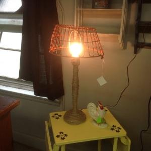 Vintage orange egg basket lamp with jute covered base.