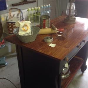 Vintage enamel colander,pastry cutters,  on kitchen island