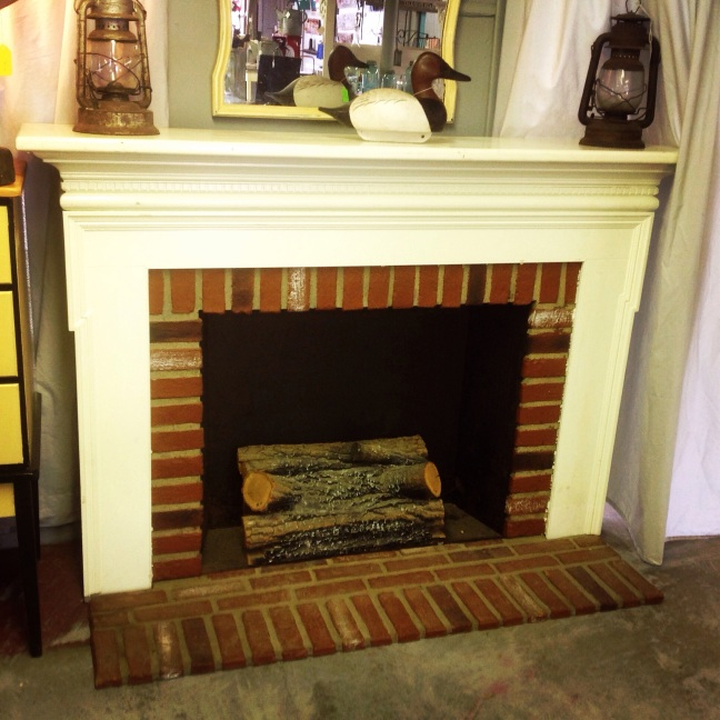 #fireplace#freestanding# wood mantle#brick