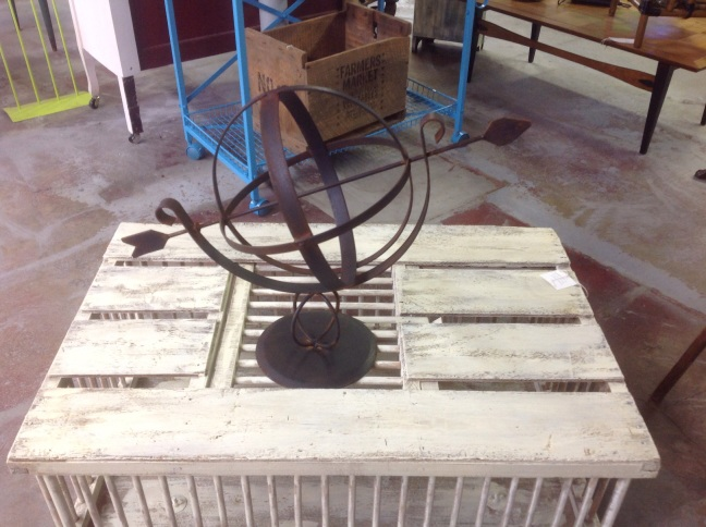 cast metal sun dial, would look great on a table or outside.